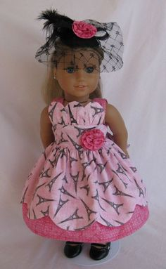 This one-of-a-kind Parisian ensemble is perfect for American Girl doll of the year, Grace Thomas. The dress is sewn from two pretty pink 100% cotton prints: one featuring the Eiffel Tower and the other pink with polka dots on batik.