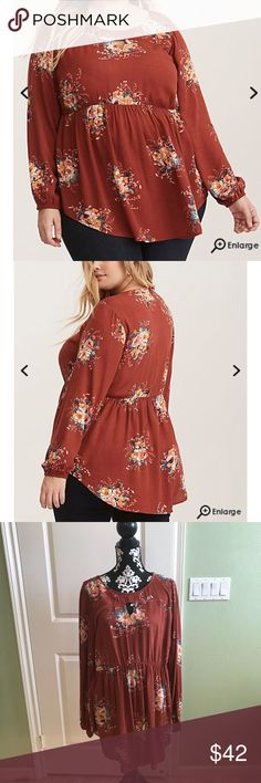 Torrid Floral Print Gauze Keyhole Tunic NWT You're gonna be wearing this tunic so often, it'll hardly ever make it back to the closet. The rust gauze is lightweight, flowy and feminine with a gorgeous multi-color floral print. The stretchy babydoll waist is flattering with a flare, and the keyhole cutout exposes a flash of skin. Torrid SZ 0 torrid Tops Blouses