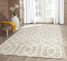 SOH411B Rug from Soho collection.  The Soho Collection is Safavieh's response to market demand for clean, transitional design in rugs that work equally well in traditional and contemporary homes. The collection's unique purity and clarity of the color is achieved by selecting only the purest premium New Zealand wool as a canvas for Safavieh's exciting new color palette. Many of the designs in the Soho collection are accented with viscose for silky softness to outline patterns, and further…