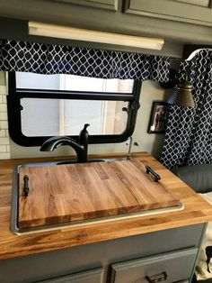 We're getting so close to being completely done with our remodel!! My awesome hubby used some of our leftover butcher block to rebuild our dinette table and to make me a cover for the sink! W…