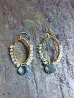 A personal favorite from my Etsy shop https://www.etsy.com/listing/512045229/aquamarine-and-moonstone-gold-hoop
