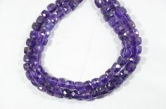 Material:- Amethyst Gemstone  Size:- 7mm-8 mm Approx  Shape:- 3D cube Box Faceted  Length:- 10 long  Color :- Blue  Product Code :- GG-143