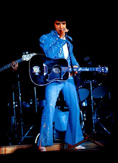 ELVIS ON STAGE IN THE BLUE NAIL JUMPSUIT IN 1972