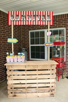 Carnival birthday party stand- popcorn and cotton candy, lemonade. Made from pallets.