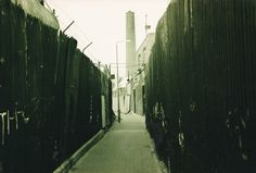 Thames Path, Greenwich, sepia photo, late 1980s. Urban decay, industrial decay.