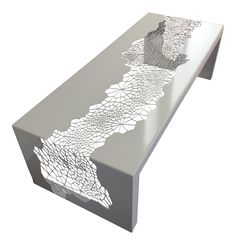 Modern white powder coated steel coffee table with a cool cellular cutout pattern.