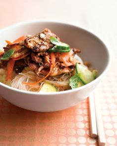Cool and crunchy, salty and sweet, this recipe combines thinly sliced chicken breasts with our Spicy Asian Dressing, cucumbers, carrots, basil, and rice noodles for a sensational one-bowl meal.