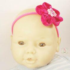 Fita elástica fina rosa com flor
