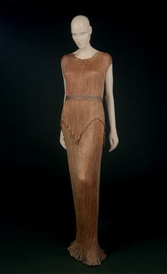Delphos gown | Mariano Fortuny | Venice | 1909-20 | Pleated silk, trimmed with glass beads, and hand-sewn | Victoria & Albert Royal Museum | Museum No.: T.193&A-1974