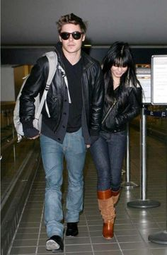 Who made Vanessa Hudgens' jeans, leather jacket, and boots that she wore at LAX Airport, December 11, 2009? Jeans – Nudie Tight Long John Skinny Jeans in Denim Stretch  Jacket – Acne Rita Leather Biker Jacket  Boots – La Canadienne