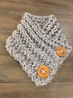 Crossover neckwarmer - This is a very comfy neck warmer, looks great under or over your jacket and has two decorative wood buttons Size : One size fits most Color : Grey. If you would like to order a different color please msg me before placing your order and I can find the best