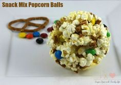 Snack Mix Popcorn Balls are the perfect movie night snack. It combines the best snack foods (popcorn, M&M's and pretzels) into an easy to grab and eat on the go snack treat. - Snack Mix Popcorn Balls Recipe on Sugar, Spice and Family Life