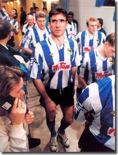 Eric Cantona in Sheffield Wednesday jersey, but Trevor Francis never signed him. (Note brick-sized mobile phone in foreground)