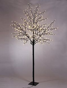 Lighted Cherry Blossom City Tree featuring 600 micro warm white LED bulbs. Wonderful for Home, Garden & Neighborhood Decorating as well as Wedding, Birthday, and Christmas celebrations