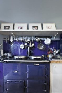maybe use some similar colors in backsplash as the aga?