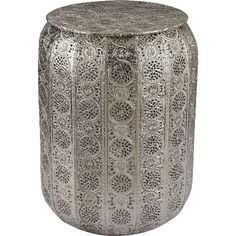 Featuring a pierced metal design and nickel-hued finish, this lovely garden stool lends a touch of texture to your living room seating group.F...