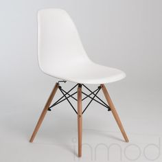 Molded Plastic Eiffel Side Chair With Wood Legs - Click to enlarge