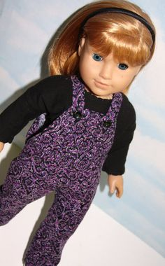 Purple corduroy overalls by SewLikeBetty on Etsy. Made following the Oh My Gosh Overalls pattern. Find it at http://www.pixiefaire.com/products/oh-my-gosh-overalls-18-doll-clothes. #pixiefaire #ohmygoshoveralls