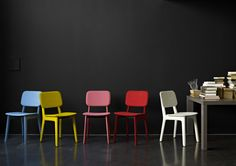 The colors of the new Felt chairs make for a beautiful contrast against this black wall.
