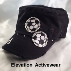 I made this soccer bling hat for one of my fitness instructors.  She was looking for a soccer hat that was unique, with a good balance of Swarovski Crystals - not too many, but enough to catch your eye.  I chose to put the two smaller soccer balls give the appearance of them bouncing across the hat.   I embroidered this one with the traditional black and white soccer balls with white Swarovski crystals $38.  https://www.etsy.com/listing/265005726/soccer-bling-hat-embroidered-soccer-hat.