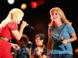 Kelly Clarkson & Trisha Yearwood, NASHVILLE, TN - JUNE 08: Singers Kelly Clarkson and Trisha Yearwood perform during the 2013 CMA Music Festival on June 8, 2013 at LP Field in Nashville, Tennessee. (Photo by Christopher Polk/Getty Images), 2013