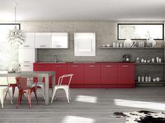 Une cuisine grise effet béton Sobre et élégante, cette cuisine mêlant rouge cerise, blanc laqué et béton s'avère être un parfait mariage. Cuisine « Harmonie », prix sur demande, Arthur Bonnet