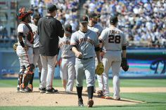 LOS ANGELES, CA - MAY 10: Pitcher Matt Cain #18 of the San Francisco Giants leaves the game in the sixth inning against the Los Angeles Dodgers at Dodger Stadium on May 10, 2014 in Los Angeles, California. (Photo by Lisa Blumenfeld/Getty Images)