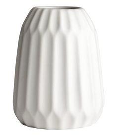 White. Large vase in textured stoneware. Inner diameter at top approx. 2 1/4 in., height 7 in.