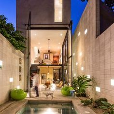 House of the Week: Tropical Home Opens Through a Two-Story Swinging Door | Dwell