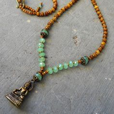 108 bead aromatic sandalwood and green crystal Buddha pendant necklace