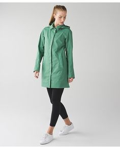 Rain On Jacket in vintage green - Go-go gadget trench coat! This classic trench has a few not-so-classic features: a removable hood,  secure pockets and a media pouch with cord exit. Two-Layer Twill fabric repels rain and reflective details help keep us on the radar (even when we're incognito).