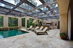 Outdoor living. Love the stone flooring.