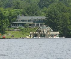 Modern cottage and boathouse in traditional Muskoka style