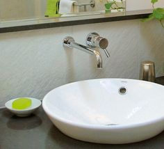 We have 2 round vessel sinks in our master bath. Small Ikea bowls ...