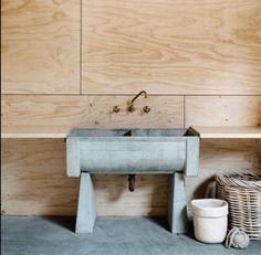 Concrete laundry tub.