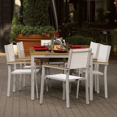 Comes with one (1) Travira 63 inch Table - Teak and six (6) Travira Armchair - Natural Sling - Teak Armcapss. This set is made of aluminum, teak, natural composite material.