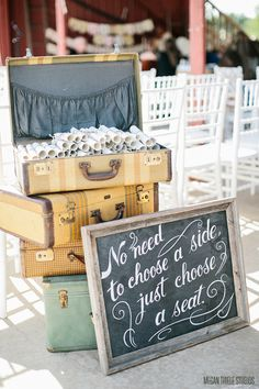 vintage suitcases / pick a seat not a side / chalkboard / wedding ceremony / programs
