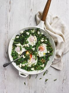 Green shakshuka  Ingredients  4 spring onions  1 clove of garlic  1 teaspoon cumin seeds  2 teaspoons coriander seeds  1 teaspoon dried oregano  olive oil  100 g cavolo nero  ½ a lemon  100 g baby spinach  50 g frozen peas  4 large free-range eggs  ½ a bunch of mint  ½ a bunch of dill  40 g feta cheese