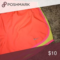 Bright orange Nike shorts Worn but in great shape. My initials are sharpied into the inside liner, but it is not noticeable whatsoever when wearing! Nike Shorts