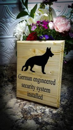 German engineered security system installed sign with German Shepherd silhouette -Wood sign approx 9x7 inches. -Each sign will vary in appearance as wood grain varies from each piece of wood. -Wood is cut, routered, sanded, & lacquered (no stain) to give it the natural wood look, &