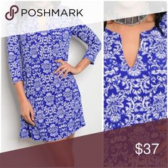 Royal blue jersey knit tunic dress! 3 qtr sleeve v neck detail royal blue and white floral tunic dress easy to wear- soft and beautiful - relaxed fit 33 inches in length Tops Tunics