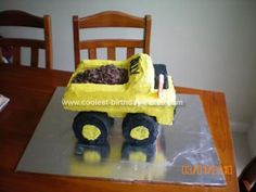 Homemade Tonka Truck Cake: My husband and I decided to attempt our first ever cake for my son's 1st birthday.  We baked for 2 days and assembled and iced over 2 days.  We found it
