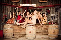 We are so doing this!!! This is an AMAZING photo for the bridal party at a winery shower!!! Bubbles and Bliss might be better suited for bottles of Champagne though...and I shouldn't have a problem getting Tessa and the girls up on the bar ;)
