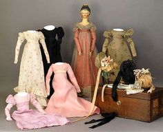 Early 19th century Grodnertal doll with a trunk and wardrobe, including bonnets. 1