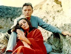 Stormy: Elizabeth Taylor and Richard Burton in their 1965 film The Sandpiper. Film critic Barry Norman says their relationship stopped Burton from becoming a great actor