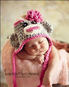 Crochet Baby Girl Sock Monkey Earflap Hat with flower - Photo Prop - made to order. $20.00, via Etsy.