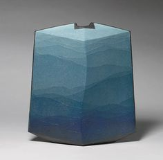 bluevase Image above: Vase by Miyashita Zenji, 2001 from The Metropolitan Museum of Art  In textiles, you can achieve the ombré fade through dip dying. The same effect can be achieved in glass or ceramics. In ceramics, Japanese artist Miyashita Zenji has perfected the art of saidei – a technique of applying overlapping, irregular and extremely thin bands of tinted clay in graduated hues from top to bottom to create a graduated color scheme.