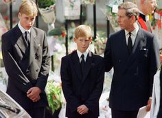 Prince Charles touches the shoulder of his son Harry as his other son Prince William watches the hearse bearing his mother Diana, Princess of Wales being driven from Westminster Abbey following her funeral service September 6. Millions of mourners lined the route to pay their respects. (Reuters)