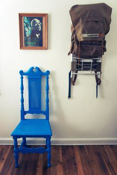 an antique chair coated in rubber by RubbishFurniture