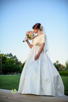 Silk satin and lace modest wedding dress.  Photo: Lasting Images Photography -- I am falling in love.